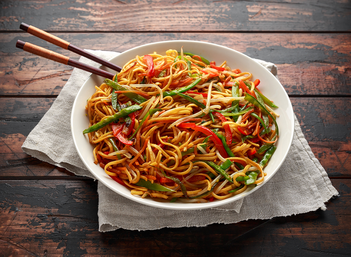 bowl of chow mein with chopsticks
