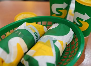 closeup of subway subs with drinks