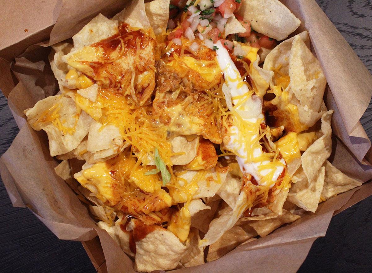 closeup of taco bell cantina chicken enchilada nachos box