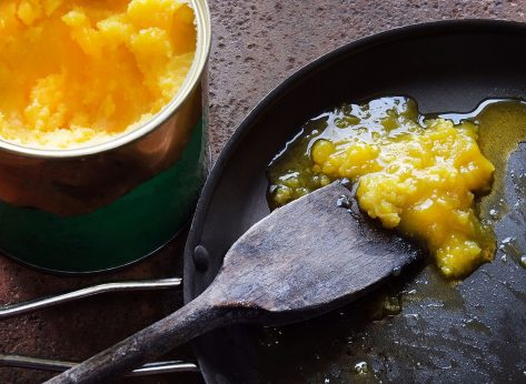 cooking with ghee in a back pan