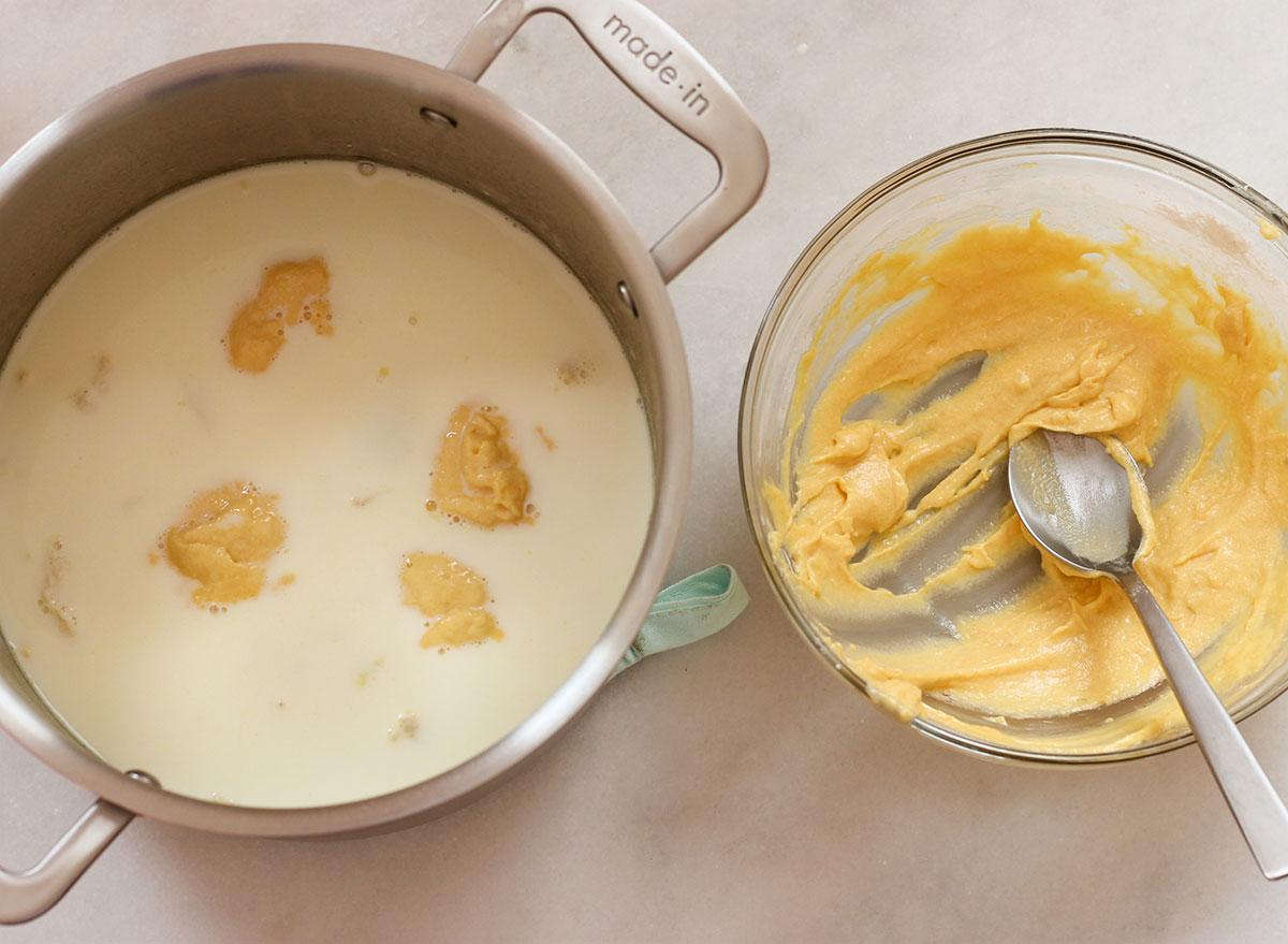 Dropping dumpling mixture into the stockpot