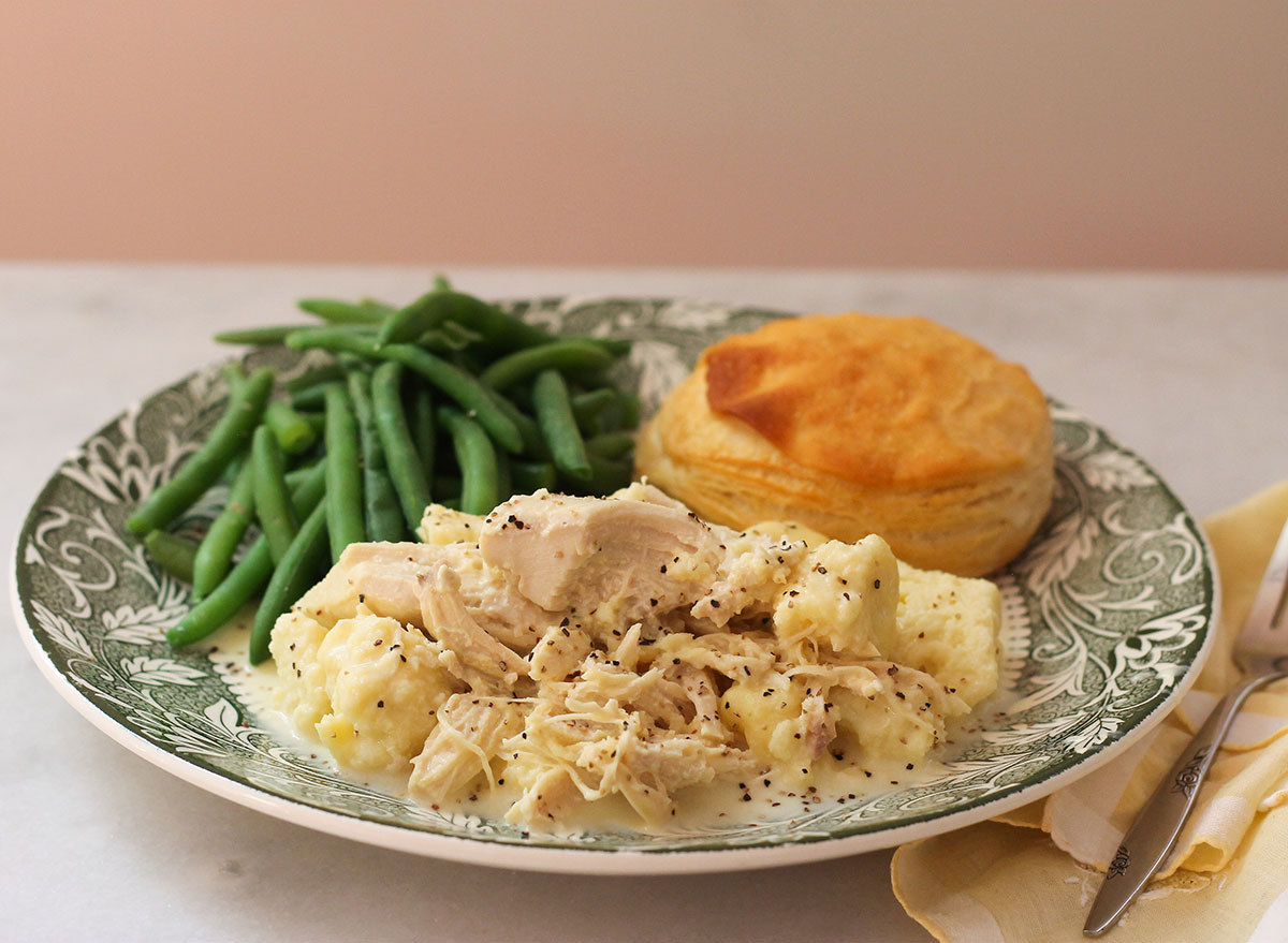 Copycat Cracker Barrel Chicken and Dumplings with a biscuit and green beans