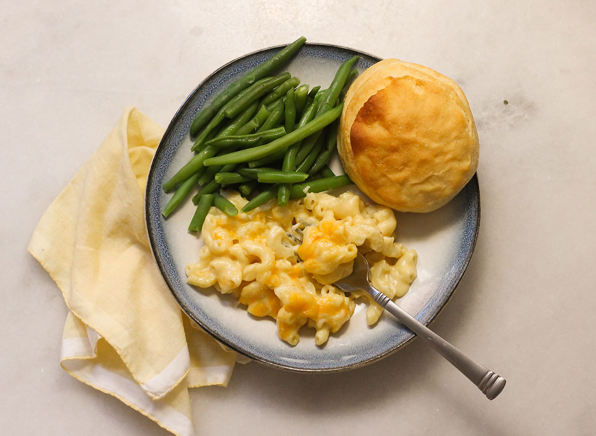 Cracker Barrel mac and cheese with green beans and a biscuit on a plate