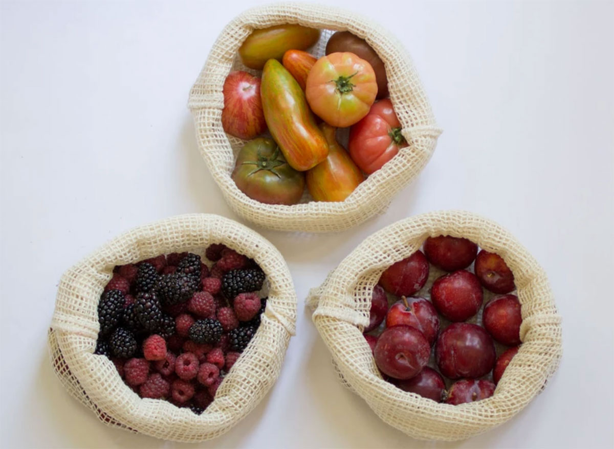 cotton mesh produce bags filled with tomatoes plums and berries