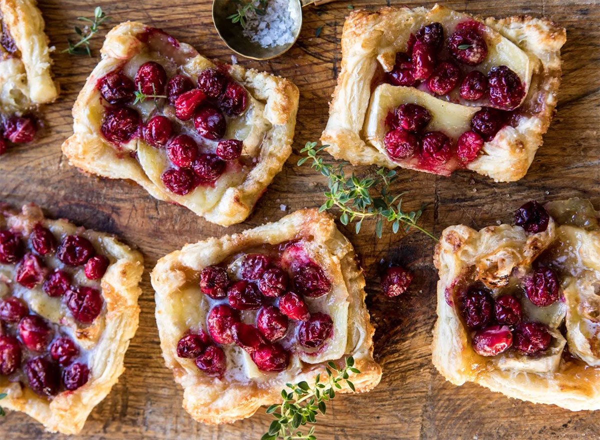 cranberry brie pastry tarts on wooden board