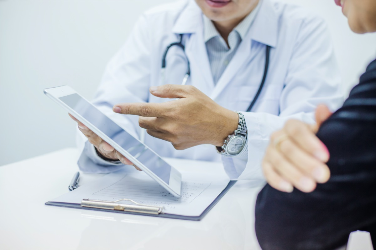 Doctor consultation with the patient by using digital tablet