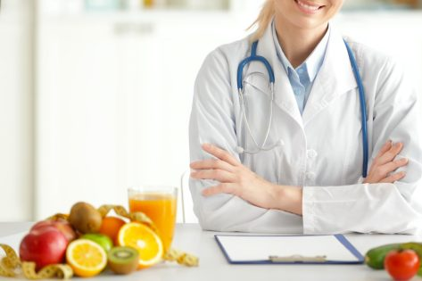 female nutritionist working in her office
