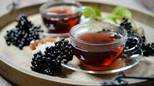 A bottle of homemade elderberry syrup