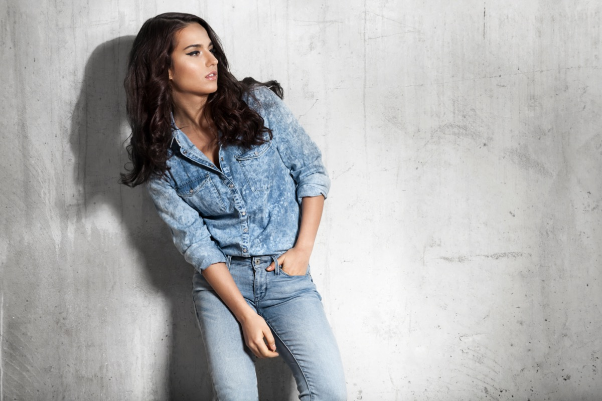 woman in jeans and a denim shirt