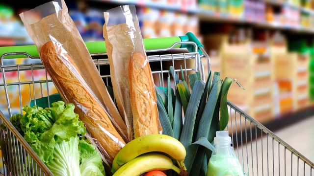 Fresh groceries in a shopping cart at the grocery store