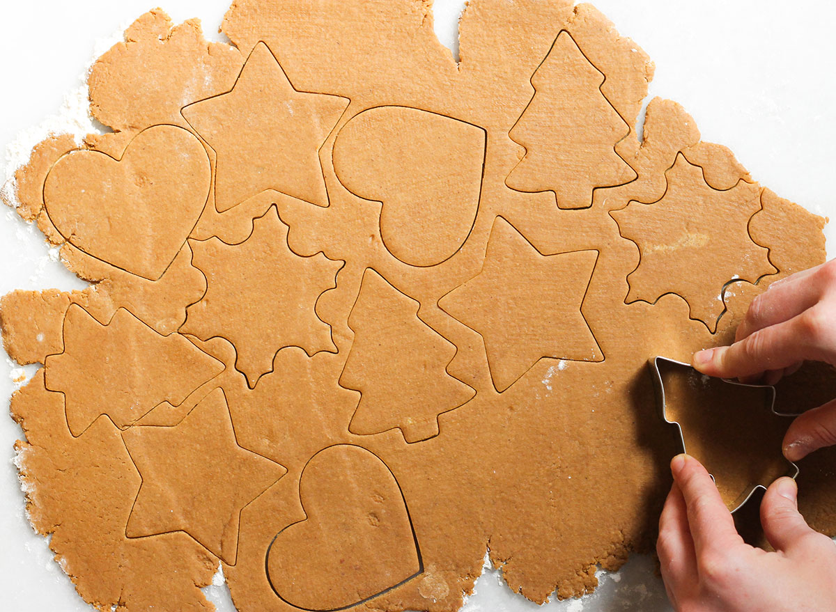 gingerbread cookies cut into shapes with cookie cutter