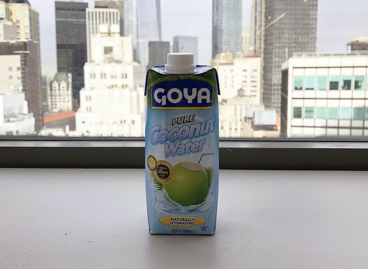 goya pure coconut water bottle in front of window