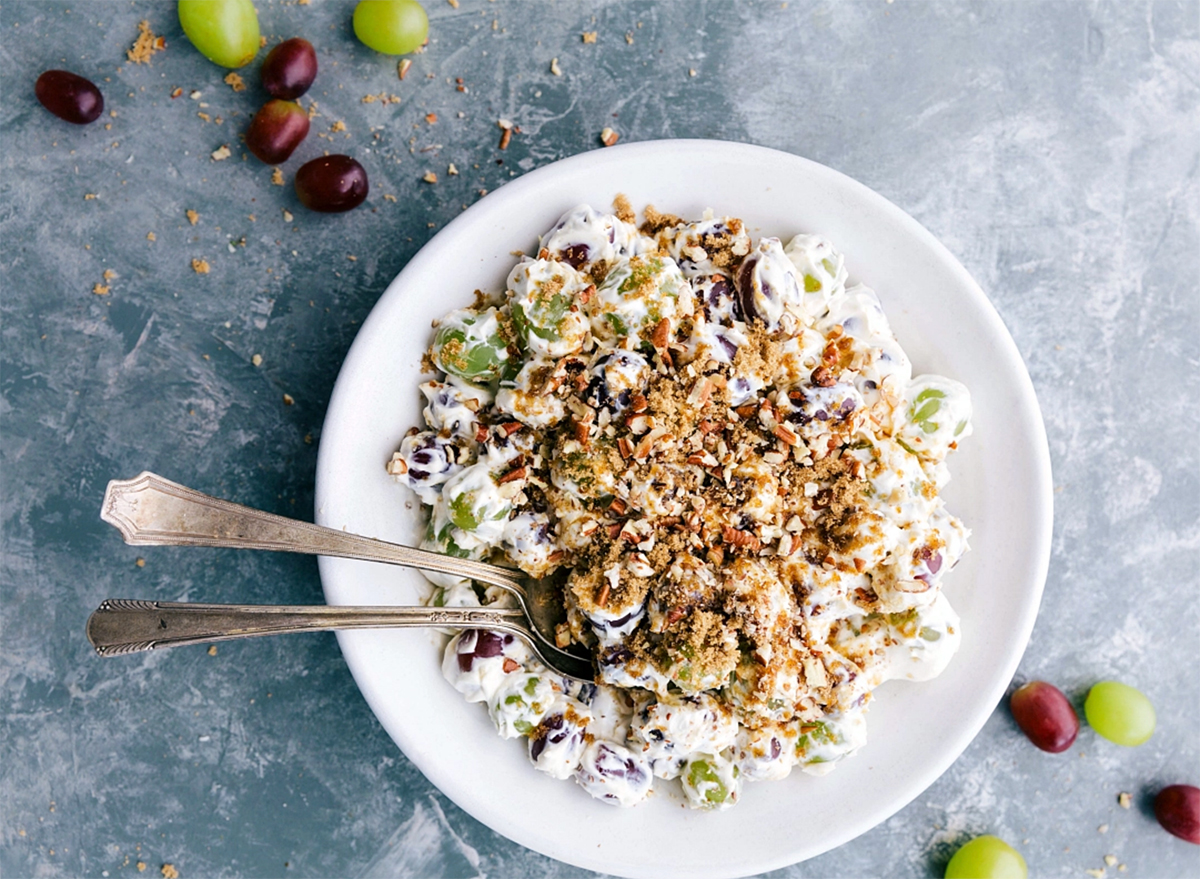 bowl of grape salad with two spoons