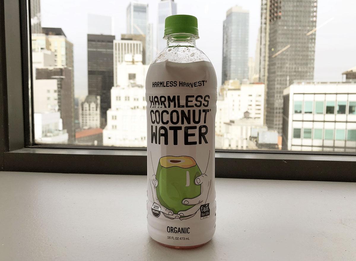 harmless harvest organic harmless coconut water bottle by window