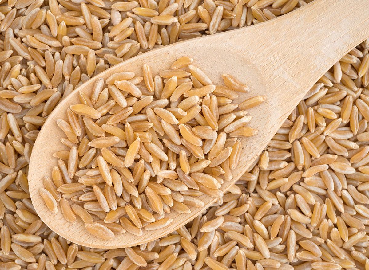 khorasan wheat on wooden spoon