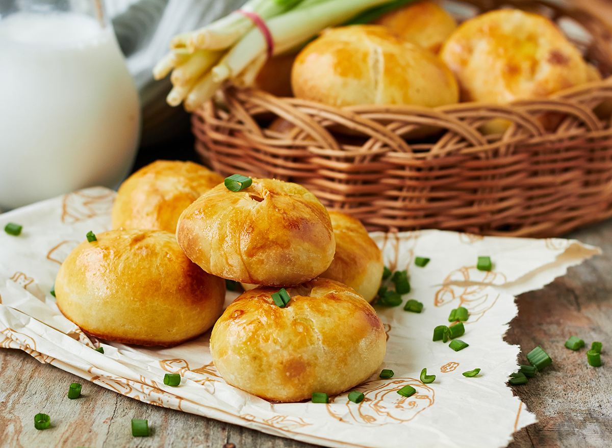 knishes stacked on a wooden surface