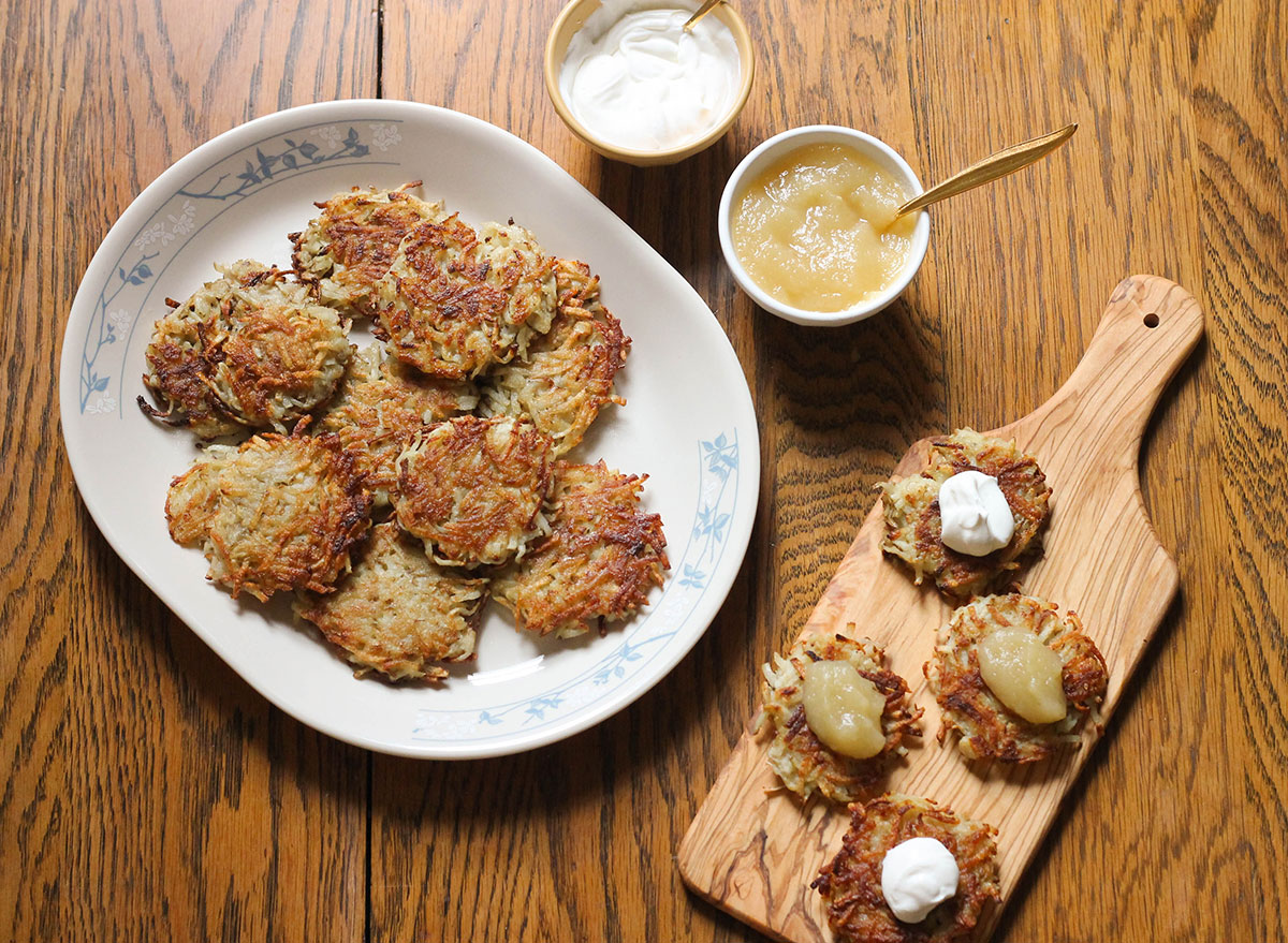 Latkes with sour cream and applesauce ready to be eaten