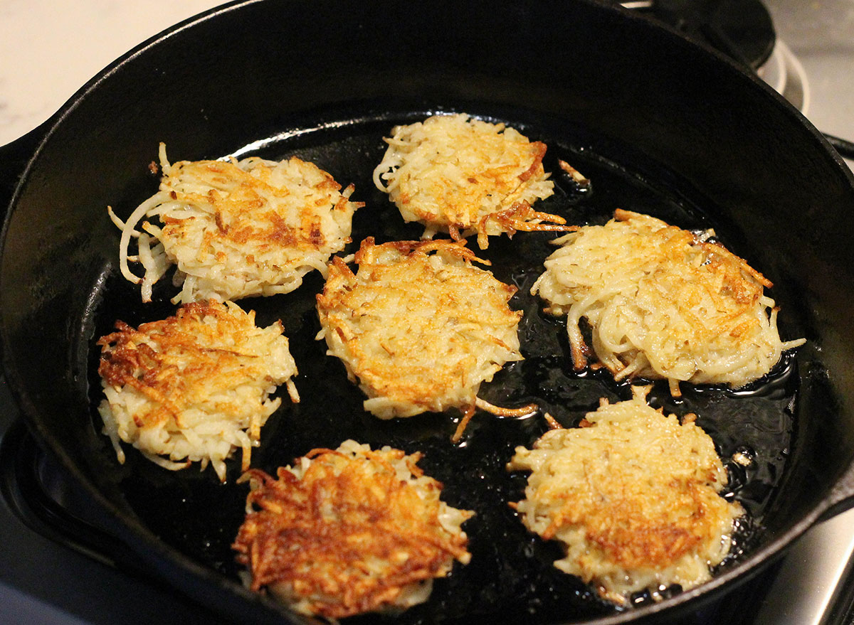 Frying up latkes in a cast iron skillet