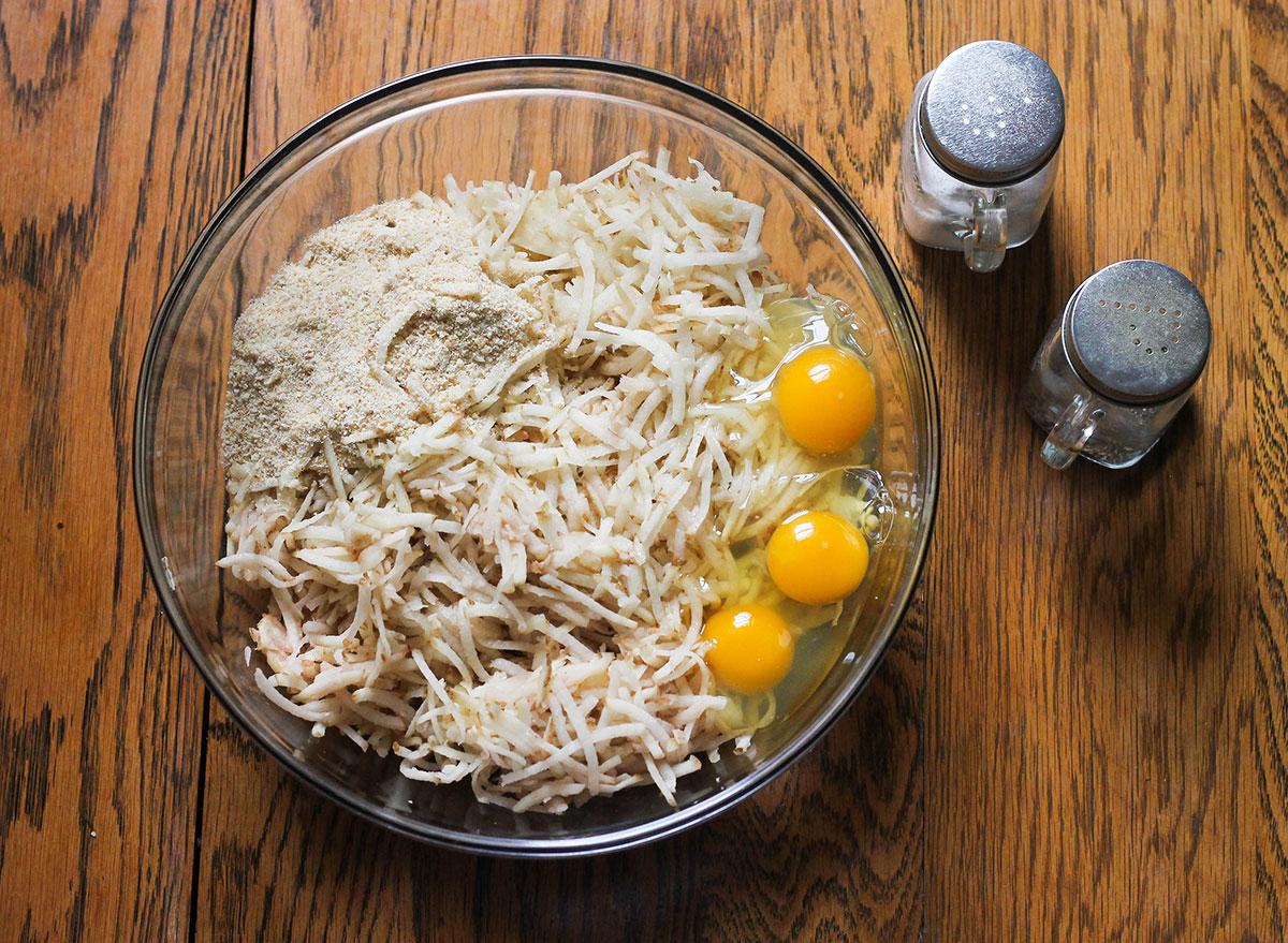 Mixing together ingredients to make homemade potato latkes