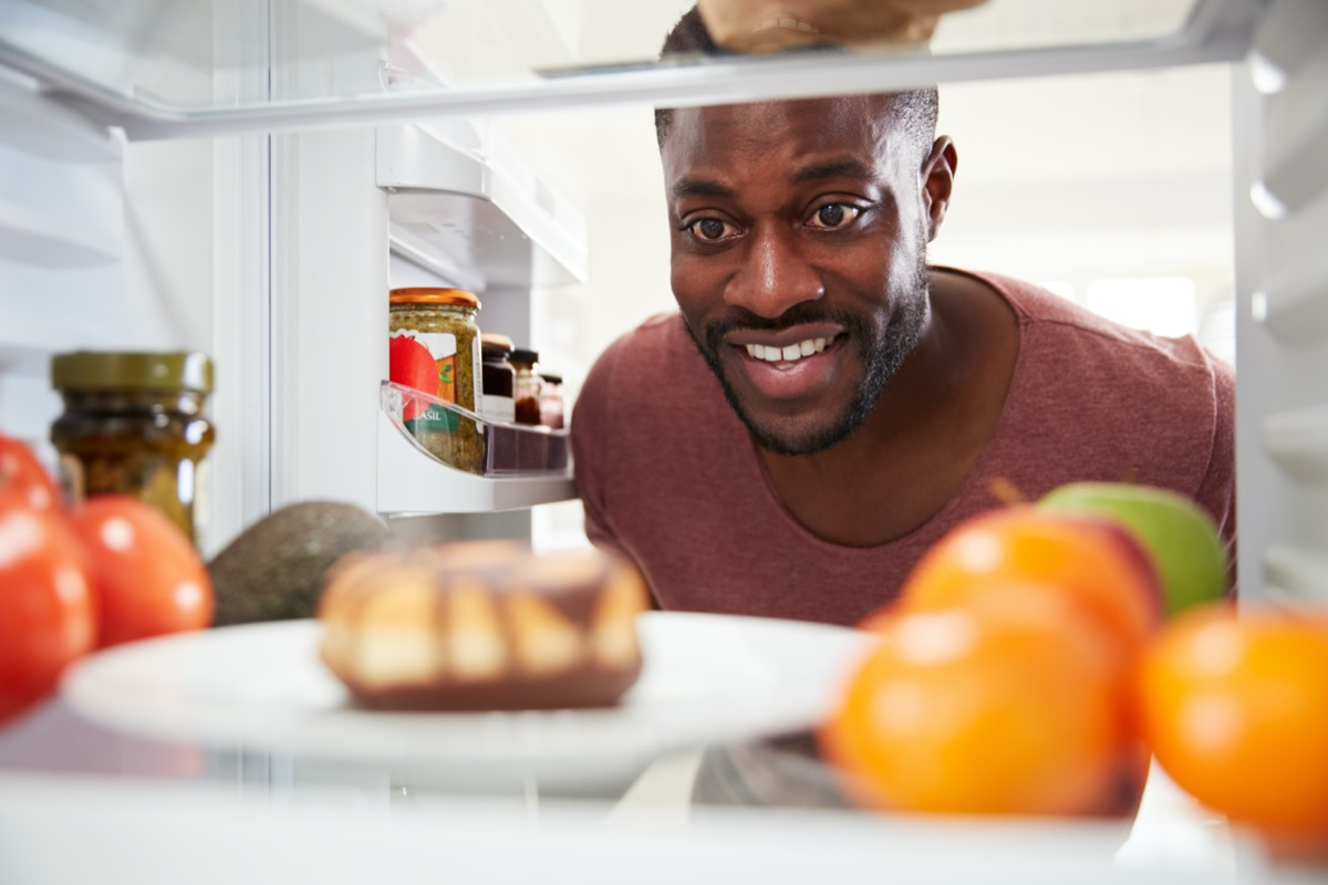 Man Opens Door And Reaches For Unhealthy Donut