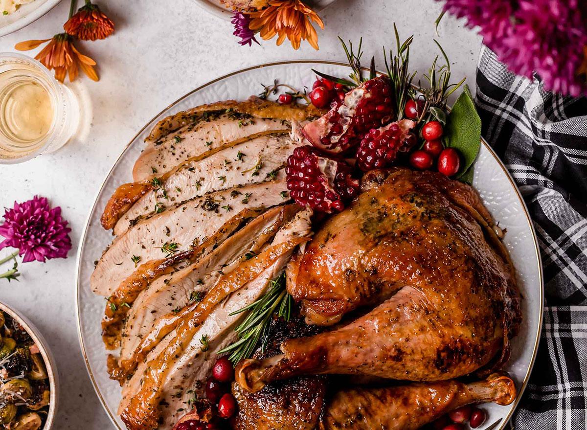 maple glazed turkey legs with sliced turkey breast on a plate