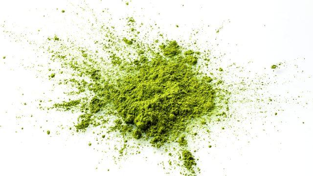 loose matcha powder on white background