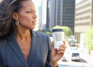Businesswoman Drinking Takeaway Coffee Outside Office