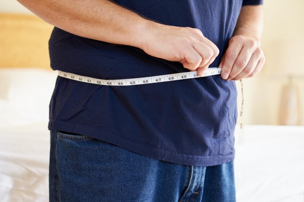 Overweight Man Measuring Waist