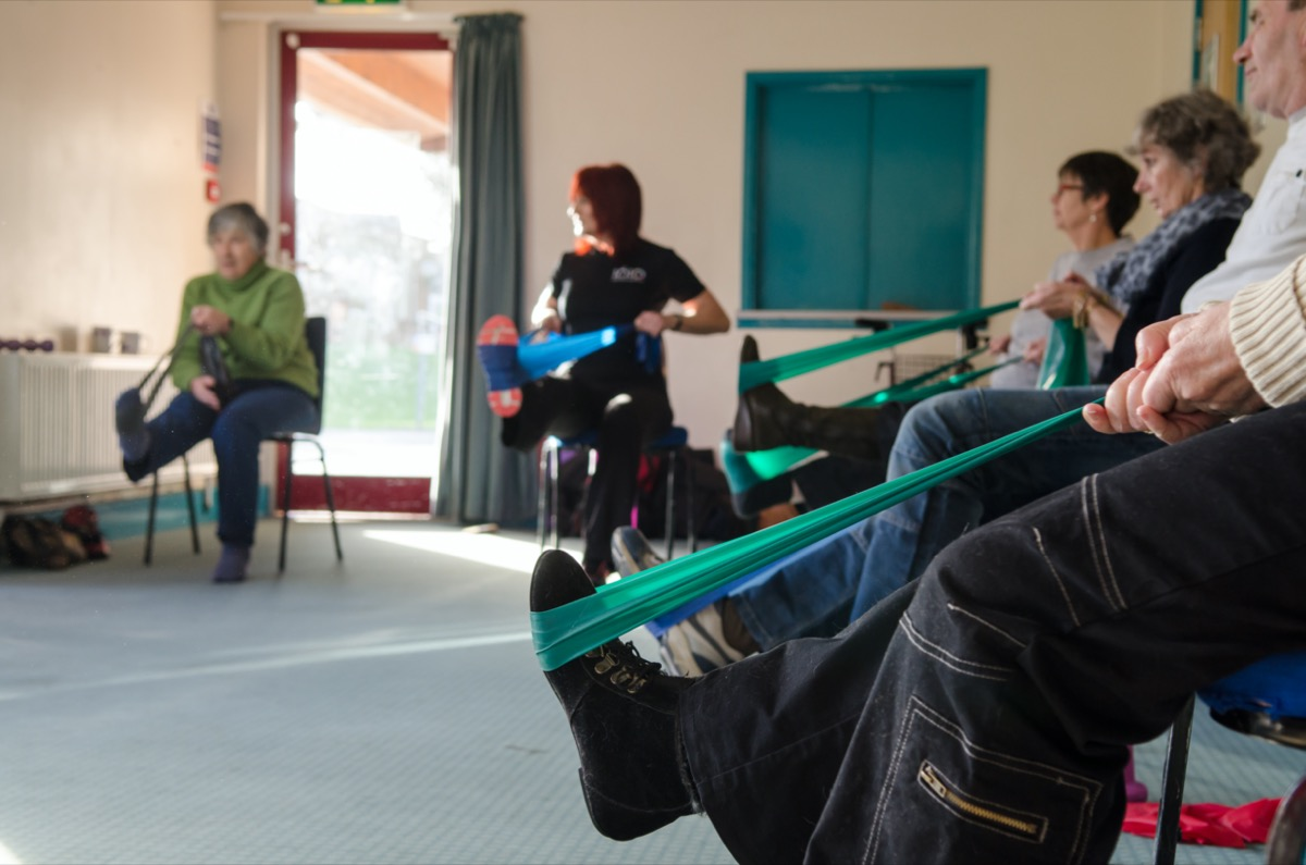 Occupational therapy instructor provides training exercises for multiple sclerosis patients at health center