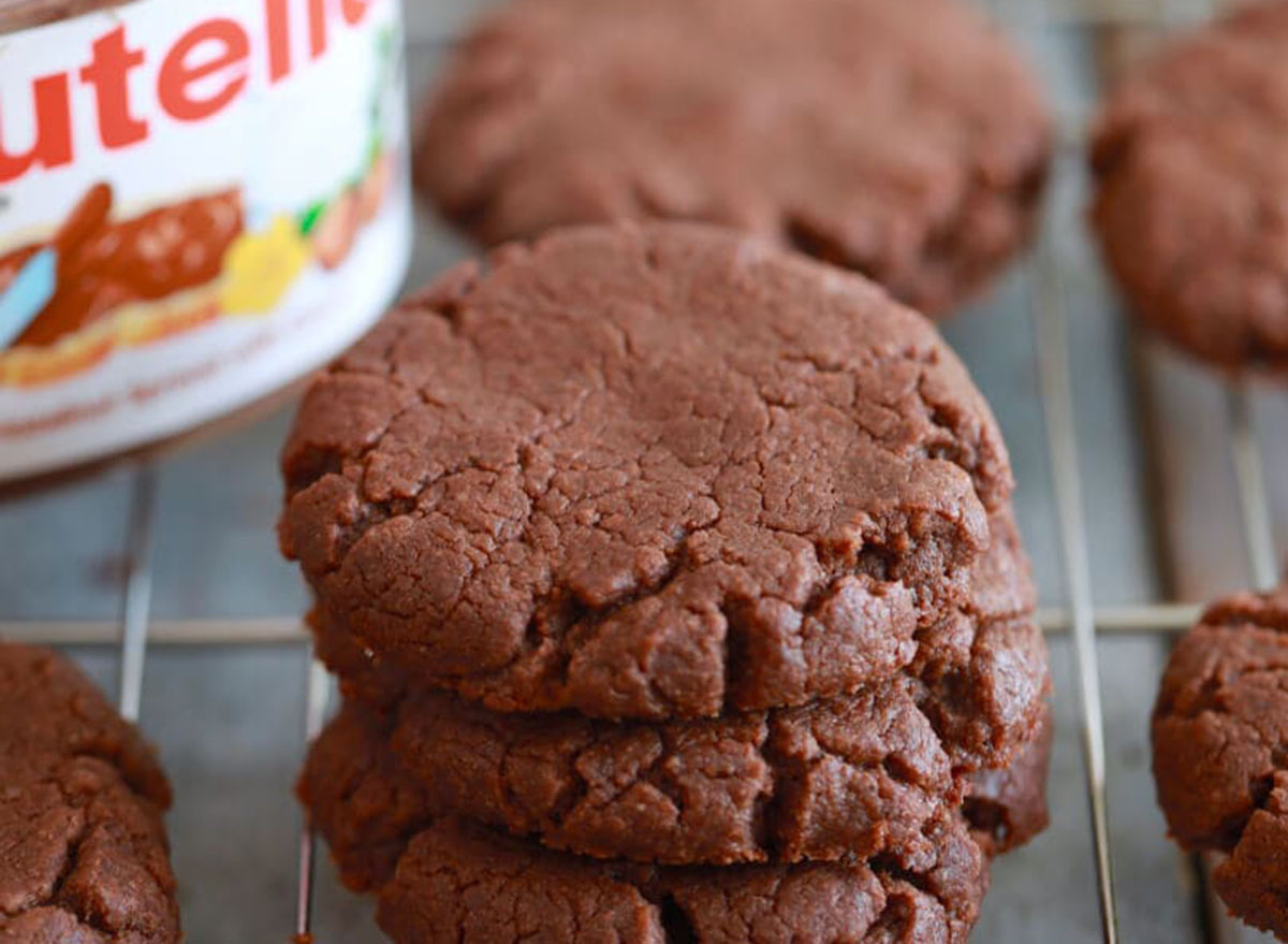 Nutella cookies on a cooling rack with jar of Nutella