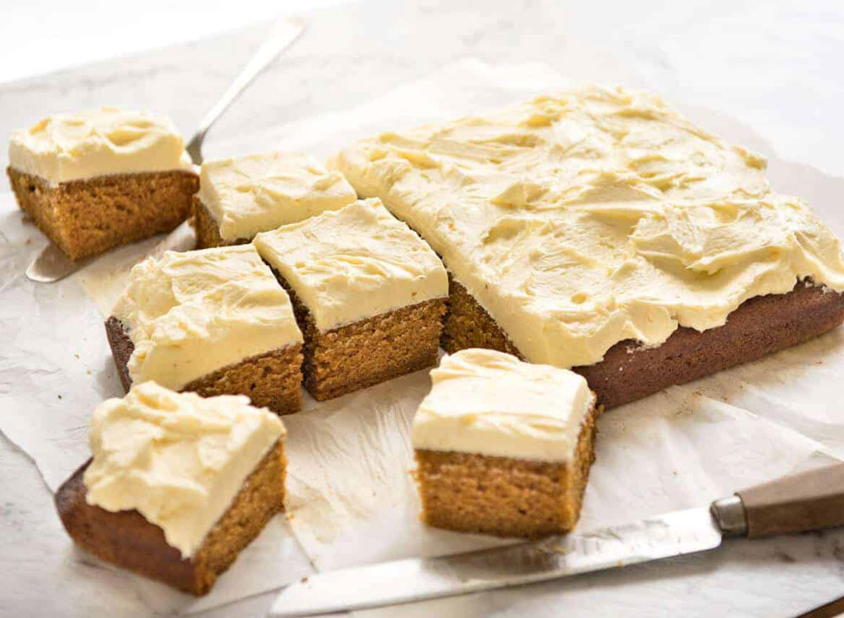 pumpkin cake with cream cheese frosting cut into squares