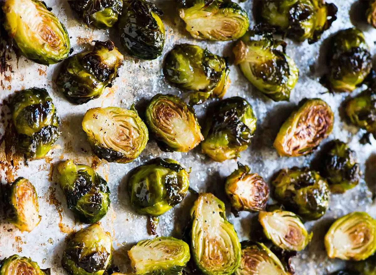 halved roasted brussels sprouts on baking sheet