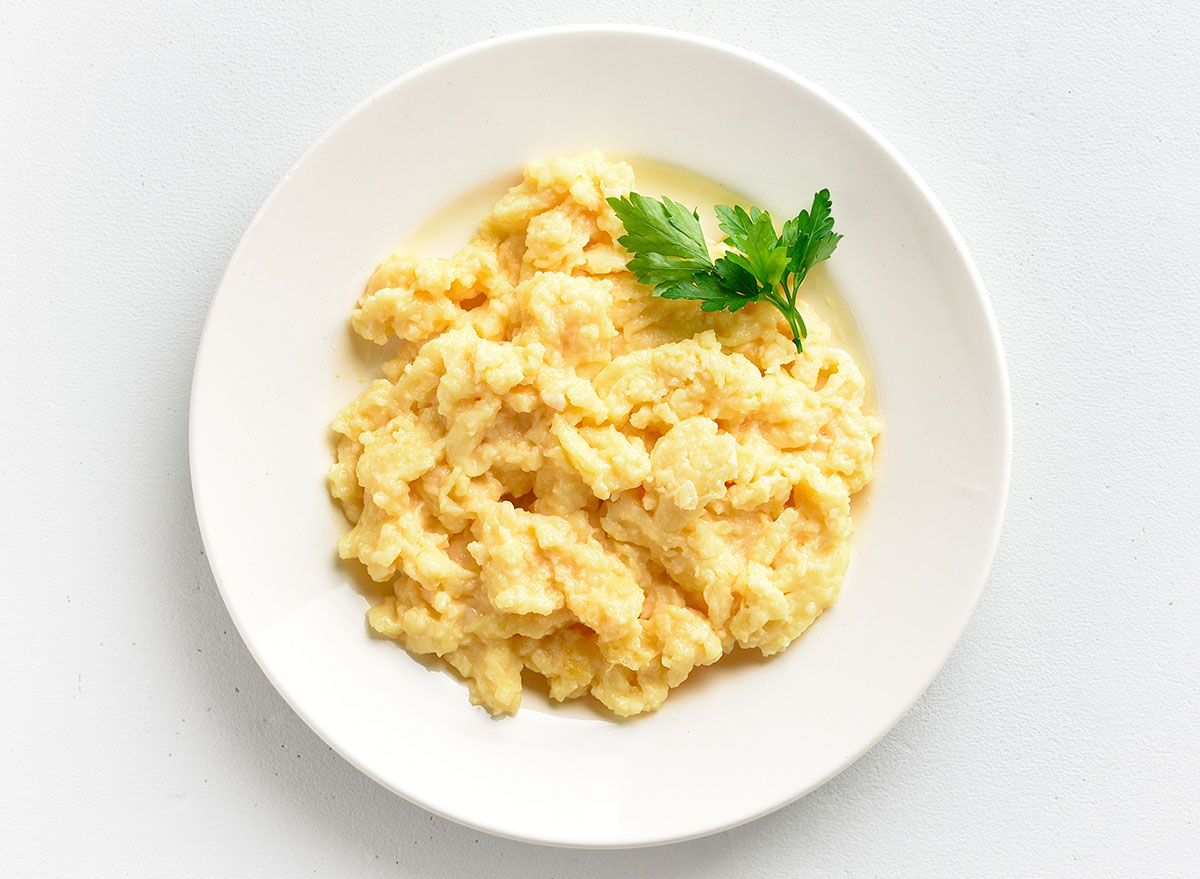 scrambled eggs on white plate with garnish
