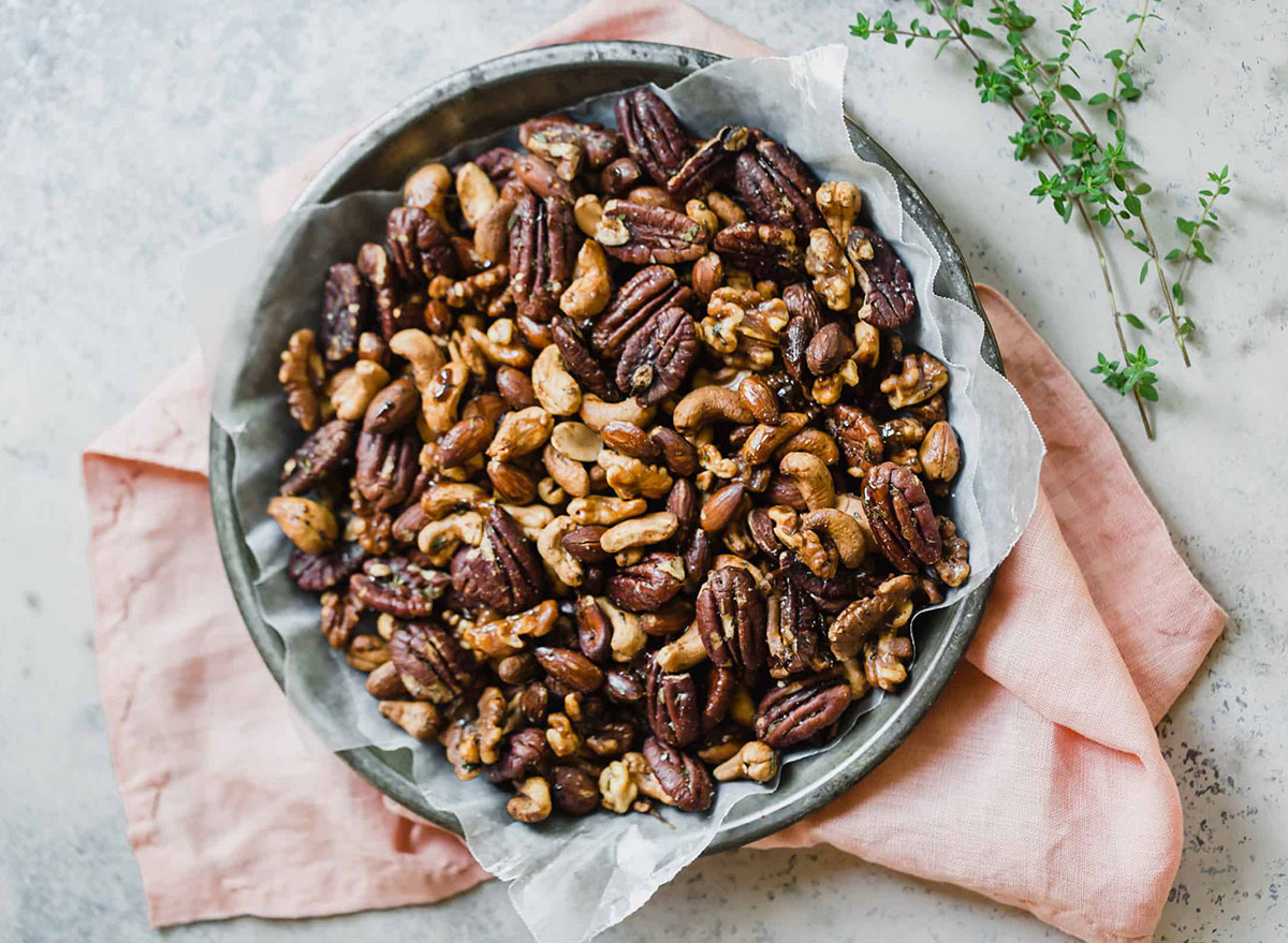 bowl of spiced nuts with cashews pecans and walnuts