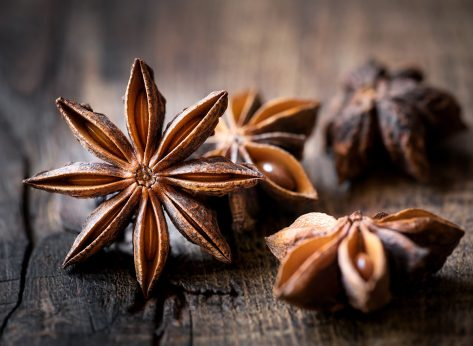 star anise on wooden surface