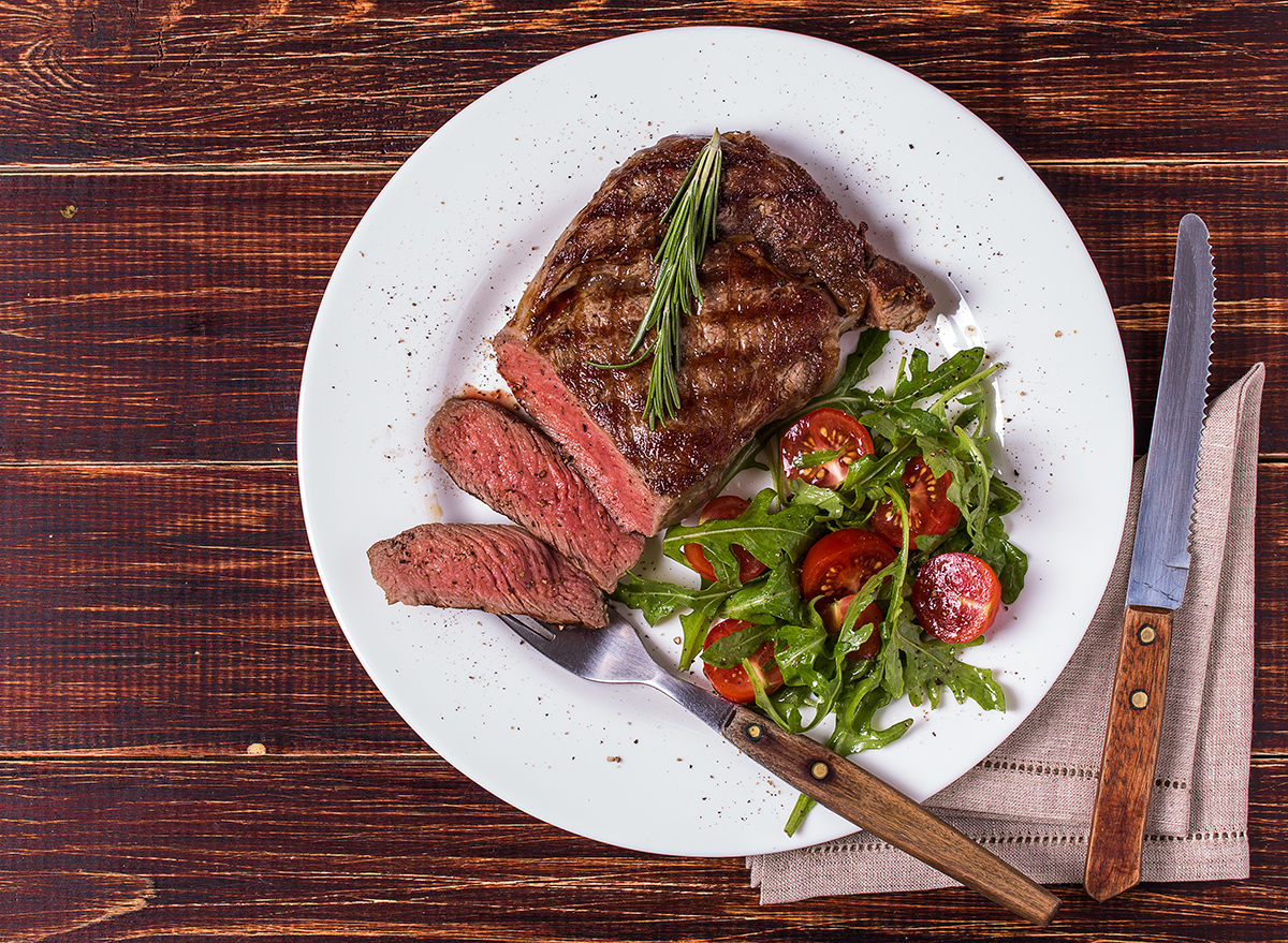 sliced steak sirloin with an arugula and cherry tomato salad