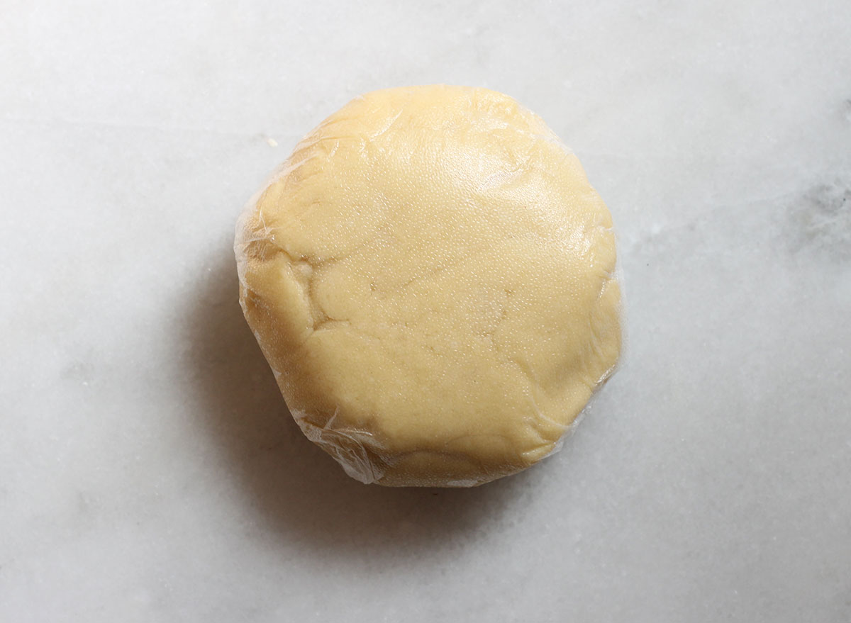 chilled sugar cookie dough wrapped in plastic wrap