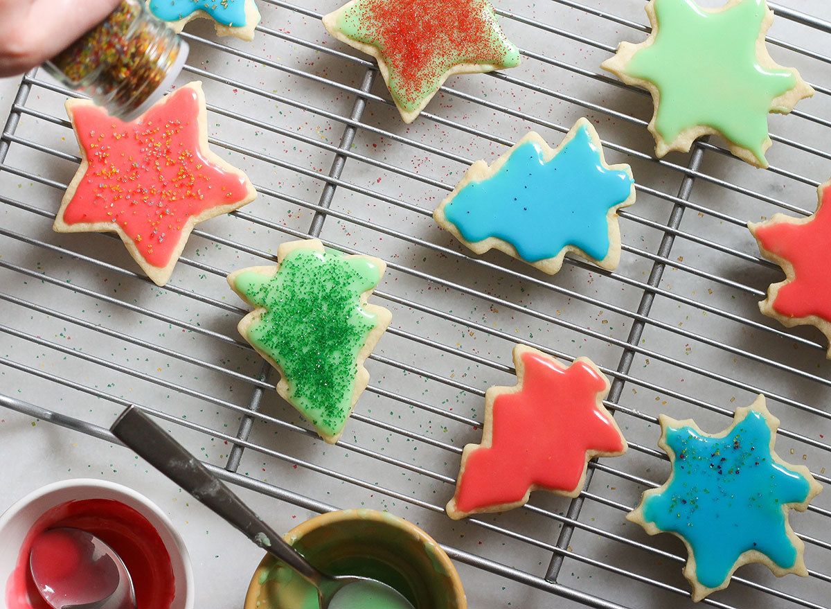 icing and decorating sugar cookies on a cooling rack