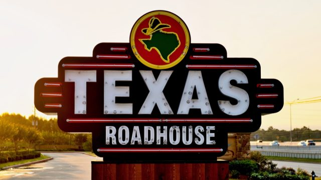texas roadhouse sign at sunset
