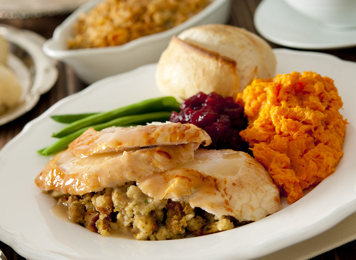 Traditional Thanksgiving dinner served on white oval plate