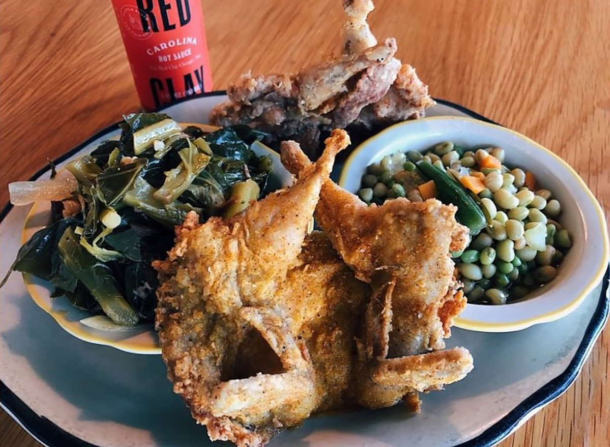 plate of fried chicken and collard greens