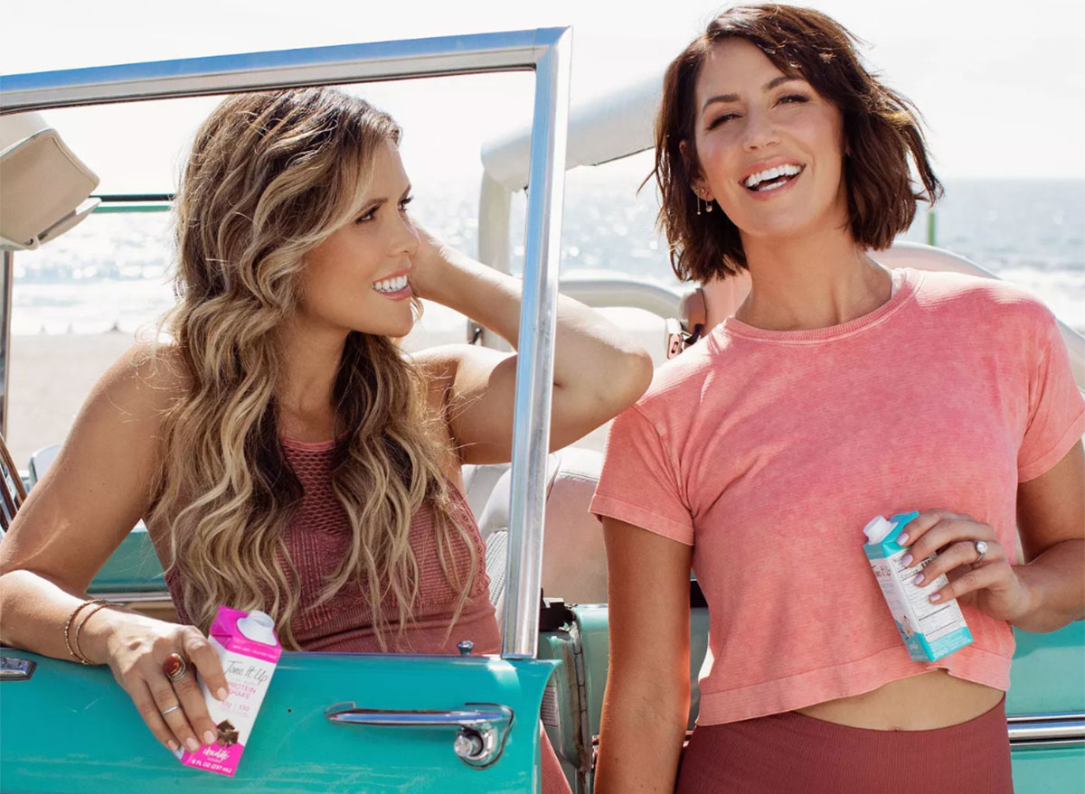 Tone It Up girls with ready-to-go protein shakes