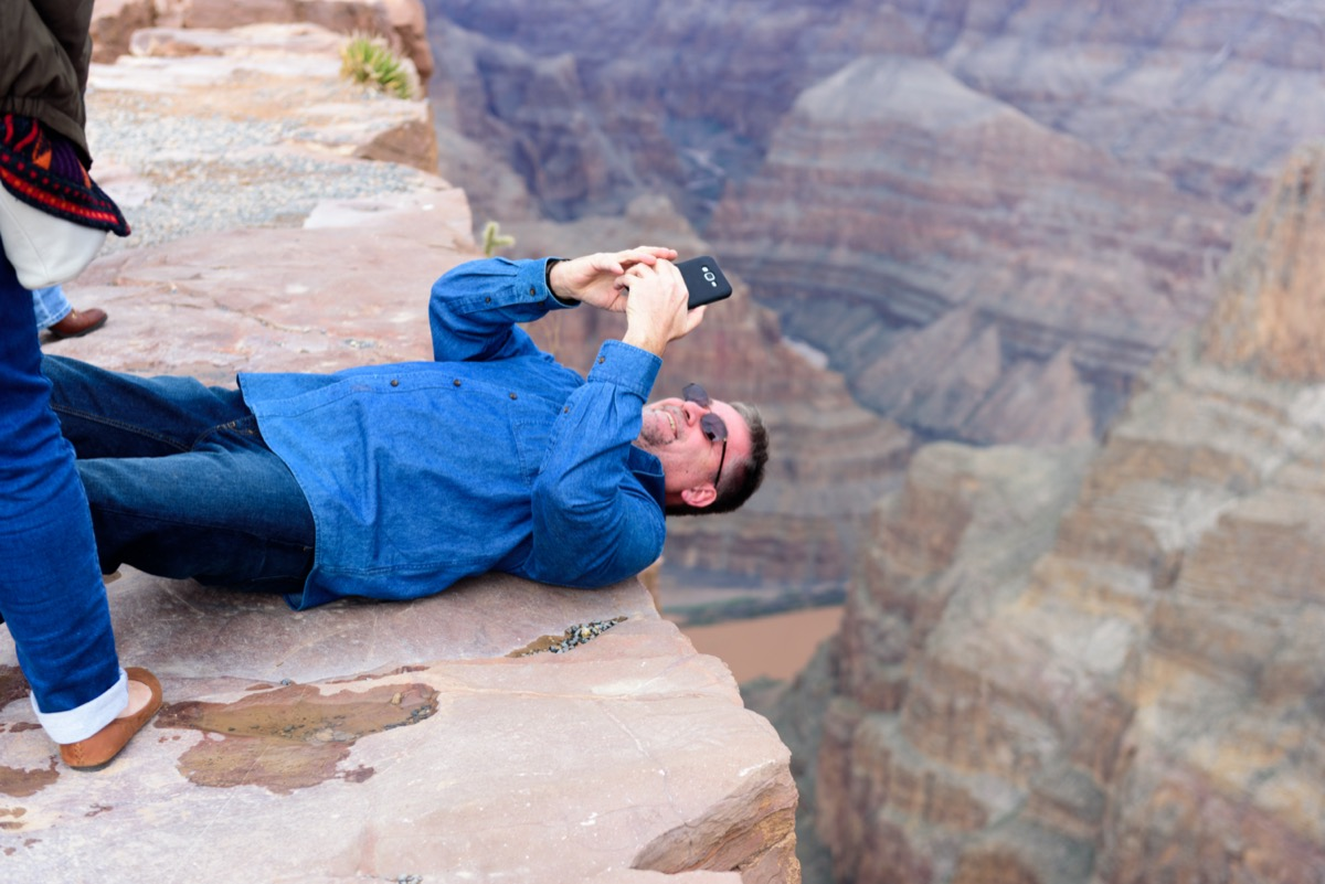 Tourist Taking pictures at Eagle Point and Skywalk at Grand Canyon West Rim