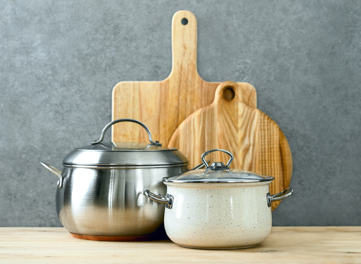 trendy cooking pots with lids and cutting boards