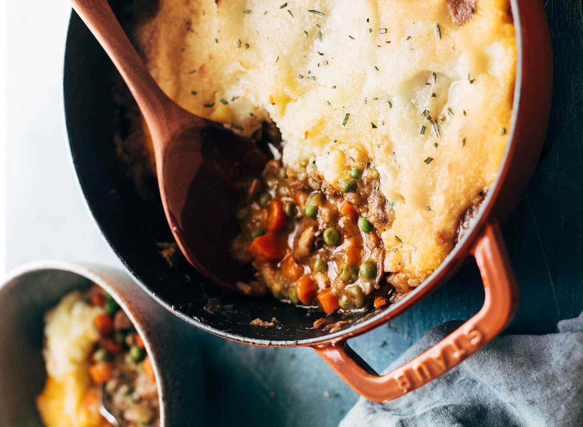 vegetarian shepherds pie with peas and carrots in baking dish