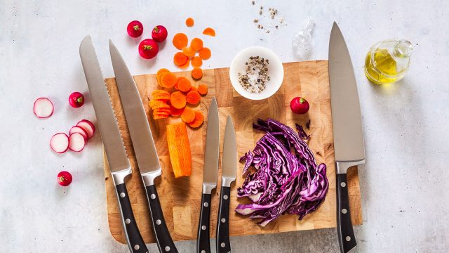 veggies and knives on cutting board