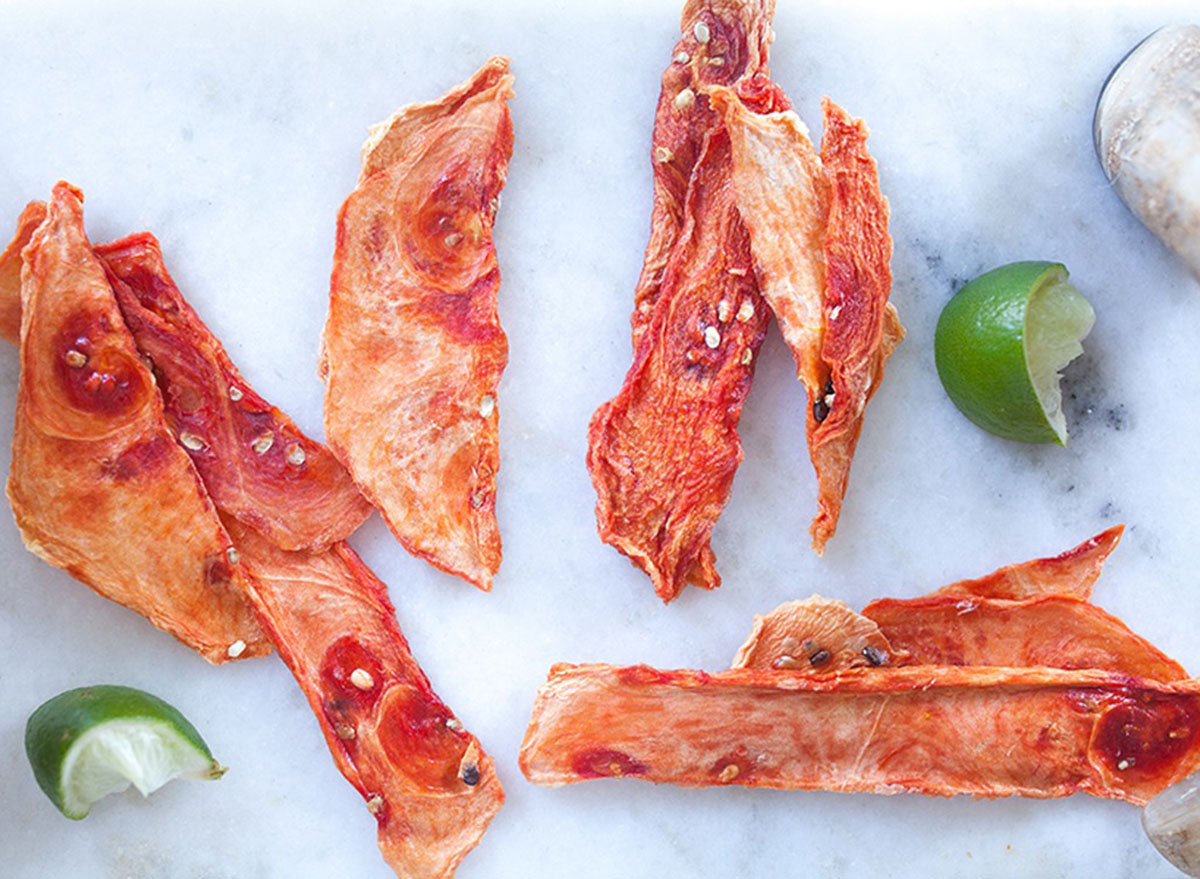 Watermelon jerky strips on a marble counter