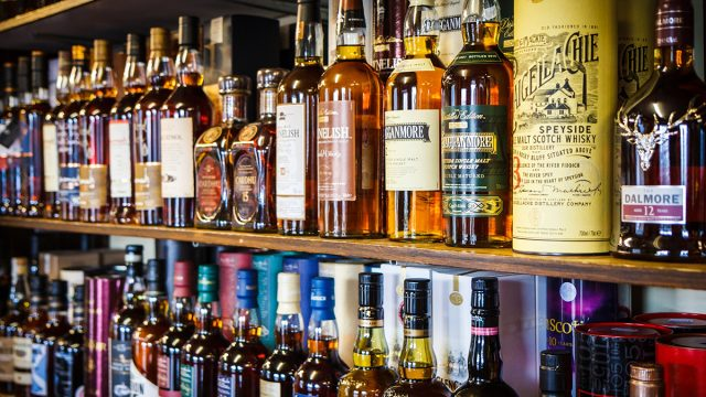 whiskey bottles on shelf