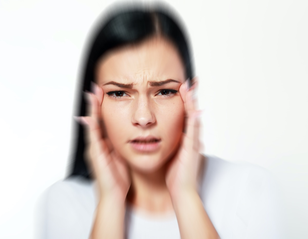 woman over white with blurred vision and trouble focusing
