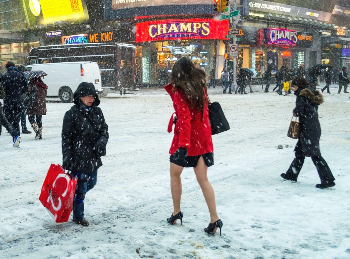 People cross the intersection of 42nd St. during the big snow storm in Manhattan